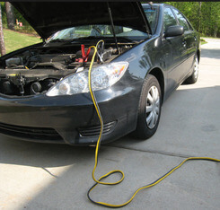 jump start a car with a dead battery by calling smitty big towing and recovery