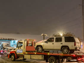 tow truck hauls vehicle in st paul